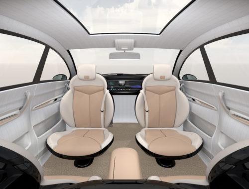 Concept d'un intérieur de véhicule autonome, avec sièges avant et arrière en face à face